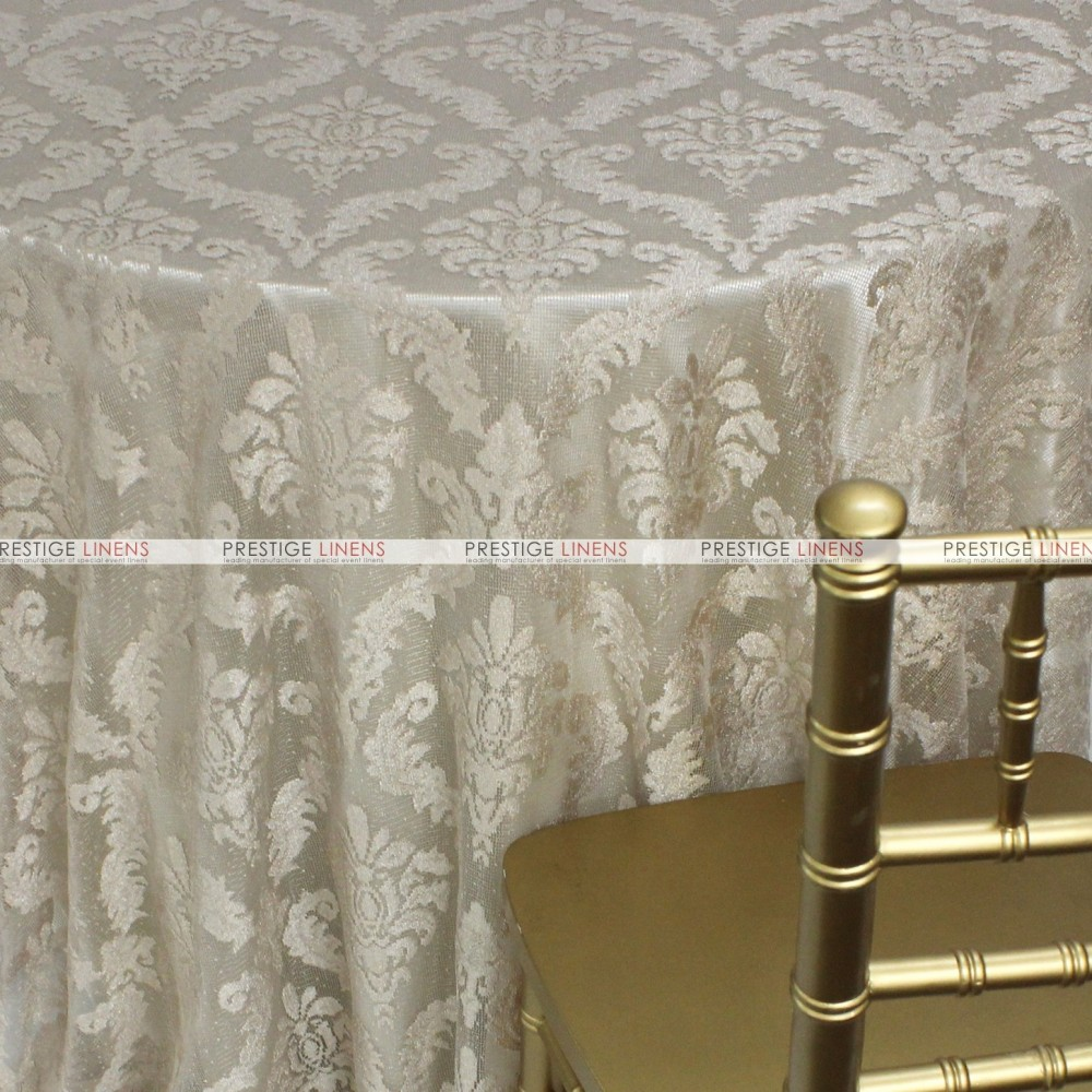 Classic lace table linen champagne prestige linens for Table linens